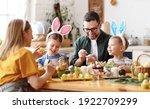 Joyful Family Wearing Bunny...