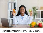 Happy Female Dietitian Holding...