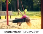 little girl swinging on swing... | Shutterstock . vector #192292349