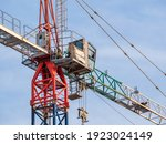Small photo of Close up details with a cabin control of a construction crane.Turret Slewing Crane against blue sky