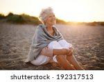 happy retired woman wearing... | Shutterstock . vector #192317513