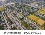 Aerial view of houses and streets in residential neighbourhood during fall season in Calgary, Alberta, Canada.
