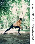 A sportswoman stretching legs...