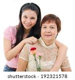 Senior Mother Holding Carnatio...