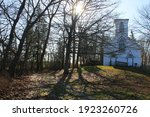A Small  White  Wooden  Rural...