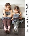 happy two girls looking on... | Shutterstock . vector #192327608