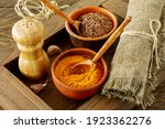 Small photo of Cloe up of Colourful various herbs and spices for cooking in bowls in wooden box.