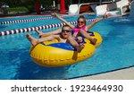 Boy And Girl On Inflatable...