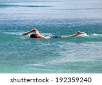 Young Sporting Man Swims In Th...