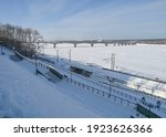 Snow Covered Embankment By A...