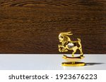 Figurine Of A Golden Ibex On A...