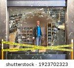 destroyed boutique showcase... | Shutterstock . vector #1923702323
