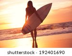 Silhouette Of Beautiful Surfer...