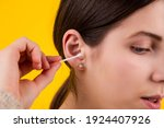 young woman cleaning her ears... | Shutterstock . vector #1924407926