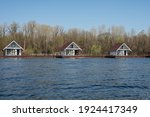 Wooden Houseboats On The River...