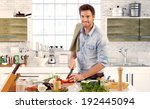 happy handsome man cooking in... | Shutterstock . vector #192445094