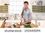 happy handsome man cooking in... | Shutterstock . vector #192445094