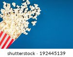Box Of Popcorn Spilled On Blue...