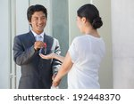 smiling estate agent giving the ... | Shutterstock . vector #192448370