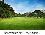 green grass field in big city... | Shutterstock . vector #192458450