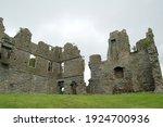 Castle Ruins In A Field In...