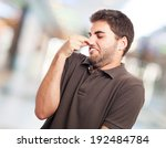 portrait of young man smelling... | Shutterstock . vector #192484784