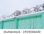 Fence With Barbed Wire....