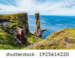 Small photo of The view to the cliffs at The Old Man of Hoy sea stack on Hoy, part of the Orkney archipelago off the north coast of Scotland