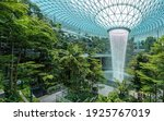 Small photo of Singapore - 30 Aug 2019: Jewel Changi Airport is a new terminal building under a glass dome, with indoor waterfall and tropical forest, shopping malls and dining, in Singapore