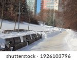 Snow Covered Park Benches....