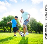 little boy playing soccer with... | Shutterstock . vector #192611048
