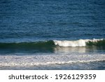 White Wave Rolling To The Beach ...