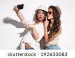 two young women taking selfie... | Shutterstock . vector #192633083