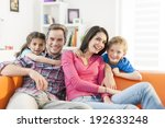 family sitting on a sofa in her ... | Shutterstock . vector #192633248