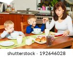 happy family. mother and blond... | Shutterstock . vector #192646028