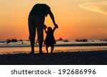 Silhouette Of Father And Littl...