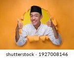 Asian Muslim Man Smiling And...