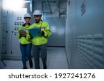 Two Worker Checking Panel In...