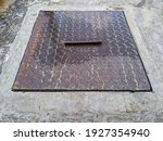Rusty Sewer Door In The Middle...