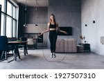 Woman Skipping With Jump Rope...