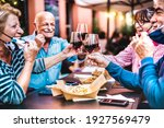 Senior People Toasting Wine At...