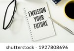 Small photo of Text Envision Your Future on notepad as business concept image