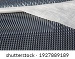 Small photo of On site: Drainage sheet made of plastic for construction or dewatering and waterproofing of green roofs, garages, terraces, closeup or textured background