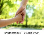 mom and daughter hands  outdoors | Shutterstock . vector #192856934