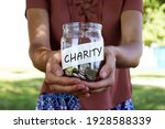 Charity. Glass Jar With Coins...