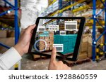 Small photo of Smart warehouse management system using augmented reality technology to identify package picking and delivery . Future concept of supply chain and logistic business .