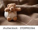 Cute Teddy Bear Toy On Warm...