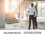 Small photo of Asian contractor and engineer inspecting material in construction building.