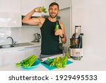 Small photo of Attractive athletic active sportive man making fresh detox homemade celery juice in juicer machine at home in kitchen. Exercise and eating healthy. Detox diet for fitness. Healthy lifestyle.