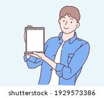 happy young man showing tablet... | Shutterstock .eps vector #1929573386